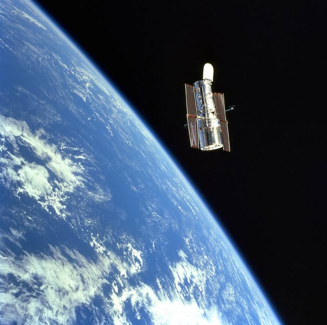 Hubble Puzzle: How Safe is a Shuttle Servicing Mission?