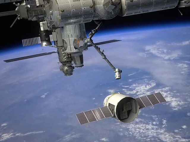 Dragon Cargo Ship Approaches the International Space Station