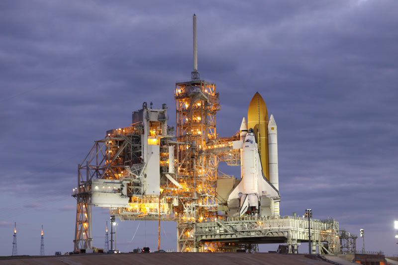 NASA Engineers Examine Space Shuttle Discovery Ahead of Repairs