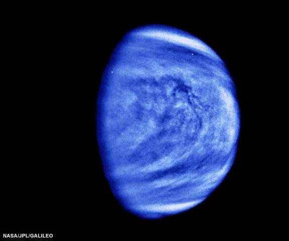 The Galileo spacecraft took this picture of Venus in 1990. It has been filtered and colorized to enhance cloud forms. The sulfuric acid clouds are somewhat similar to fair weather clouds on Earth.