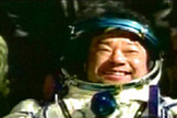 ISS Expedition 10 commander Leroy Chiao smiles widely after landing back on Earth aboard a Soyuz TMA-5 spacecraft on April 24, 2005.