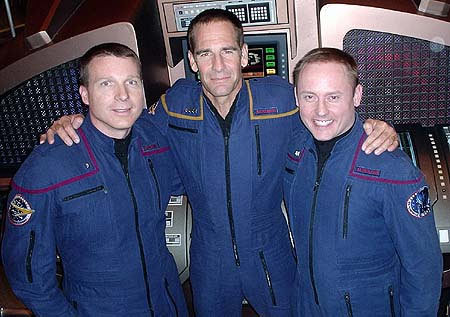 Real-life NASA astronauts Michael Fincke (right) and Terry Virts (left) dressed in Starfleet garb with actor Scott Bakula, who portrays Captain Jonathan Archer of the starship Enterprise NX-01, during taping of the final episode of Star Trek: Enterprise.