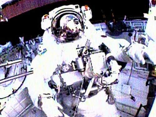 Discovery Astronauts Test Heat Shield Repairs in First Spacewalk