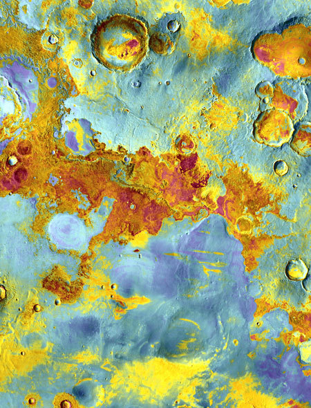 "False-color view of part of Meridiani Planum, about 250 miles (400 kilometers) northeast of where Mars rover Opportunity landed. The image was taken from NASA's Mars Odyssey orbiter using its Thermal Emission Imaging System (THEMIS) - a camera that images Mars in 5 visible and 10 infrared ""colors."" The image combines daytime and nighttime infrared views. Reddish areas have more rocks and hardened sediments, while bluish areas feature more dust, sand, and fine-grain material. Image"