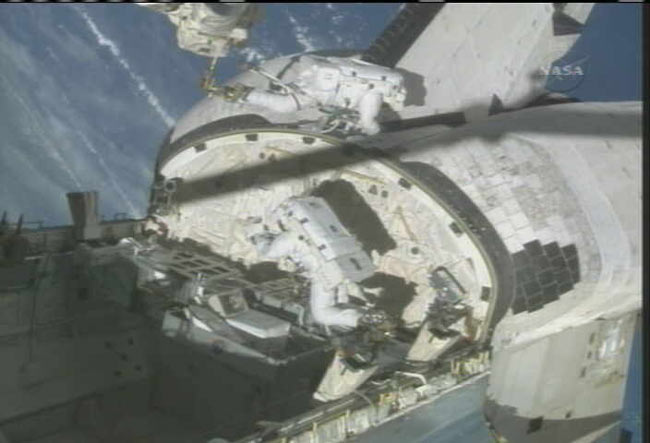 Spacewalkers Test Shuttle Heat Shield Repair Technique