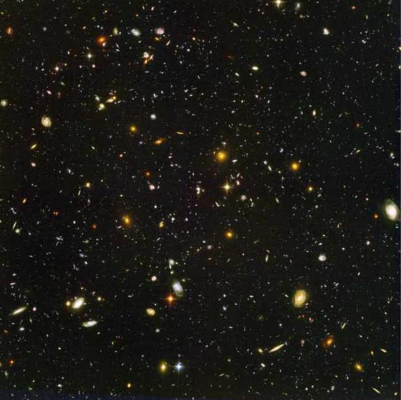 This view of nearly 10,000 galaxies is called the Hubble Ultra Deep Field. The snapshot includes galaxies of various ages, sizes, shapes, and colors. The smallest, reddest galaxies, about 100, may be among the most distant known, existing when the universe was just 800 million years old. The nearest galaxies--the larger, brighter, well-defined spirals and ellipticals--thrived about 1 billion years ago, when the cosmos was 13 billion years old.