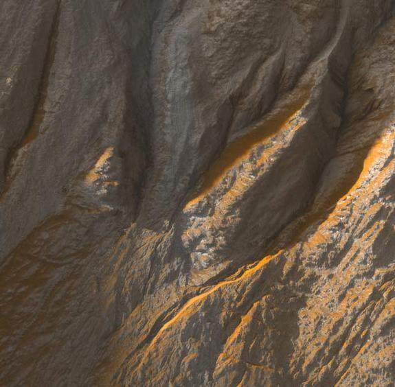 Crater edge in Terra Sirenum has been imaged by the High Resolution Imaging Science Experiment (HiRISE) camera on NASA's Mars Reconnaissance Orbiter. Gully watching thanks to repeat sweeps over the same landscape by orbiting spacecraft could catch gullies in action, if they are active today.