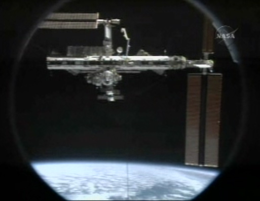 Departure Day: Shuttle Discovery Undocks From Space Station