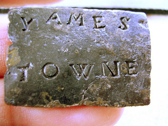 "This lead cargo tag -- which reads ""Yames Towne"" -- is believed to have been discarded from a shipping crate or trunk arriving at Jamestown, the site of the first permanent English settlement in the Americas, from England in about 1611. NASA will fly this artifact and two sets of Jamestown commemorative coins aboard Space Shuttle Atlantis in March 2007."