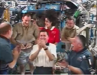 American Billionaire, Astronauts Share Smiles Aboard Space Station