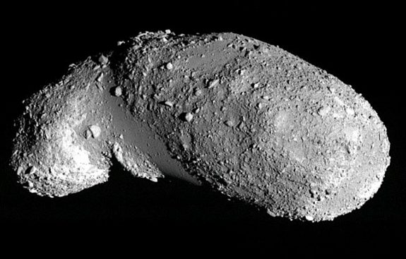 Image of the near-Earth asteroid Itokawa. The boulder-free areas appear relatively smooth and are filled with small, uniformly sized particles.