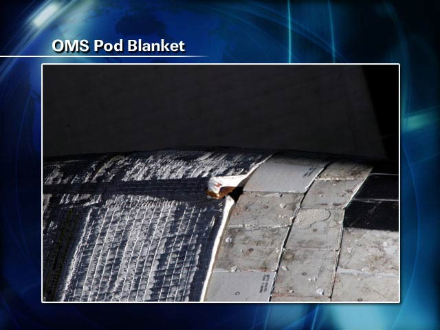Spacewalkers to Repair Shuttle Blanket, Wrangle Solar Wing