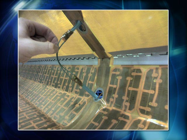 Space Station Surgery: Astronauts Mend Torn Solar Wing
