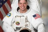 Astronaut Robert L. Behnken, missions specialist on STS-123, poses for a preflight photo.