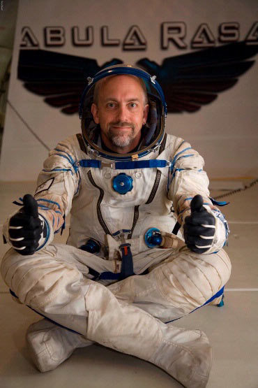 American computer game developer Richard Garriott gives a thumbs up in while wearing a Russian Sokol spacesuit during a weightless ride to celebrate the release of his new game 'Tabula Rasa.'