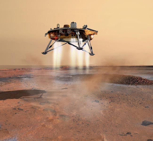 MARS MISSION UPDATE: Phoenix Mars Lander Makes 'Footprint' With Robotic Arm
