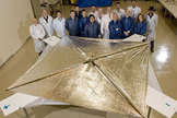The Huntsville-based NanoSail-D team stands with the fully deployed sail at ManTech SRS technologies on April 16, 2008, after the successful deployment test.