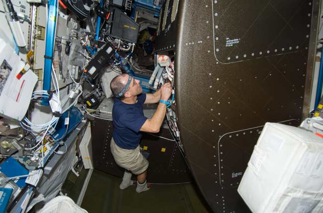 Astronauts Attempt Space Urine Recycler Repair