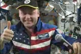 Space station commander Michael Fincke gives the Pittsburgh Steelers a thumbs up in support of their NFL playoff game.