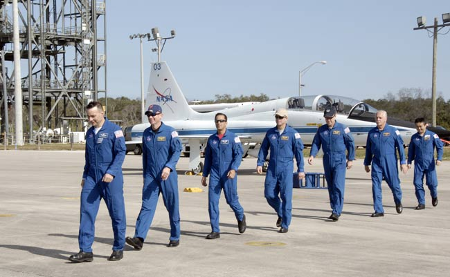 Shuttle Crew Arrives at NASA Spaceport for Training