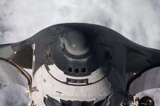 Astronauts Scan Shuttle for Space Debris Damage