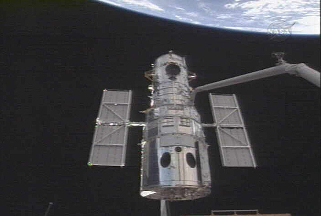 Hubble Astronauts in Space Junk Hot Zone
