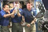 The Expedition 19 crew participates in a toast aboard the International Space Station.