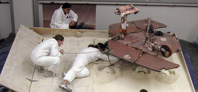 Robot Spins Wheels to Save Stuck Rover on Mars