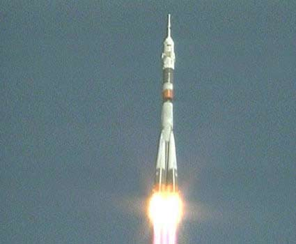 Acrobat Space Tourist Rockets Into Orbit