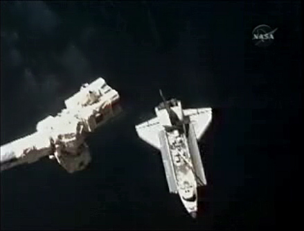 Shuttle Atlantis Arrives at Space Station