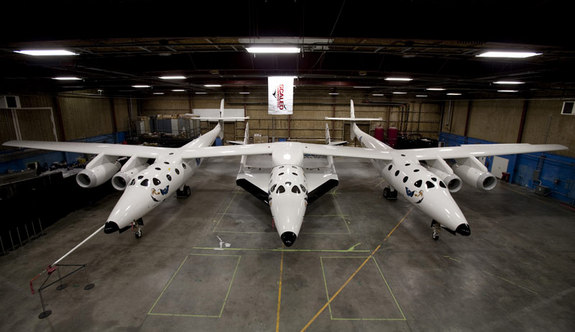 Virgin Galactic released this sneak peak of the new SpaceShipTwo suborbital spaceliner (center) attached to its carrier aircraft just ahead of their Dec. 7, 2009 unveiling.