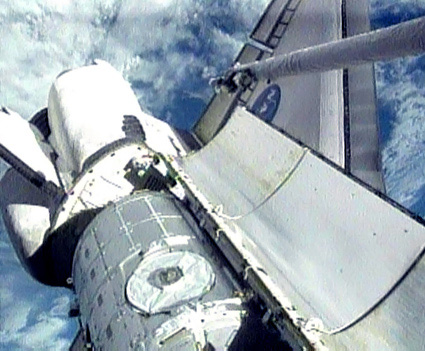 Astronauts Inspect Shuttle for Damage