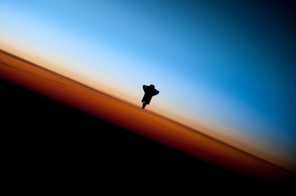 Stunning Space Photo Shows Shuttle in Silhouette