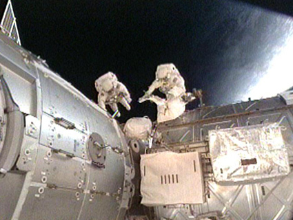 Spacewalkers Hook Up Plumbing For New Space Station Room