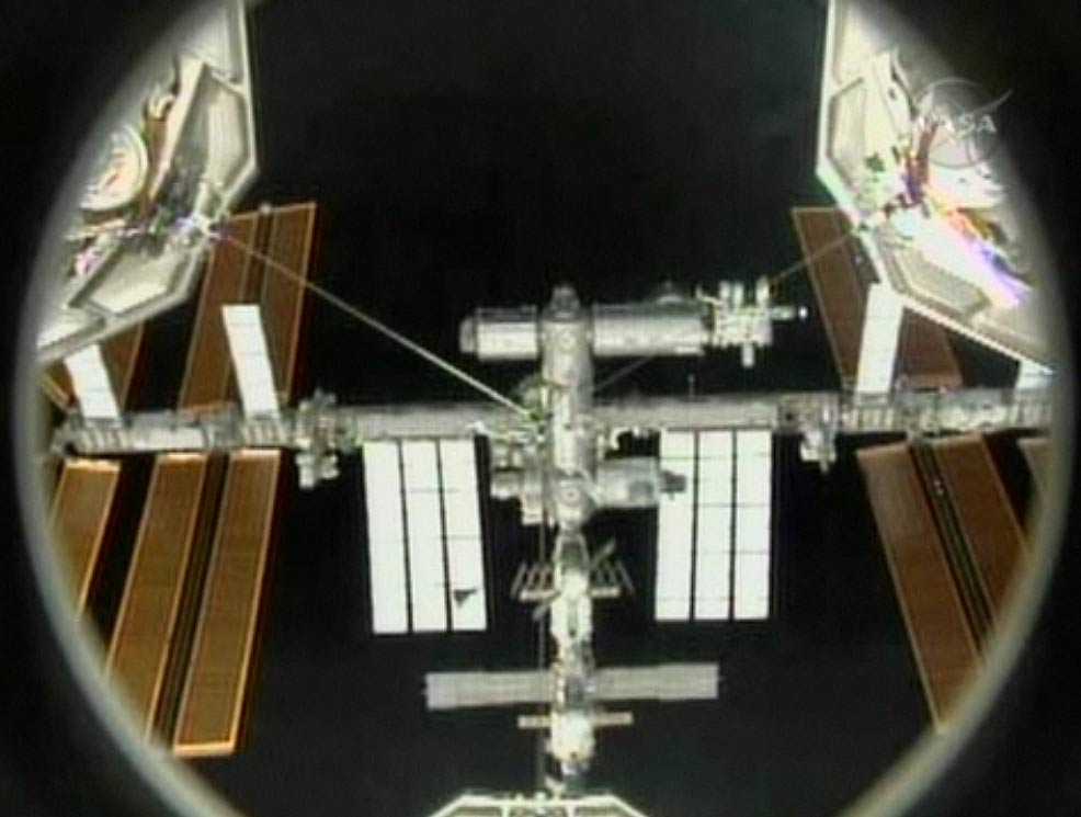 Shuttle Discovery Docks at Space Station