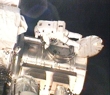 Shuttle Astronauts Take Mission's First Spacewalk