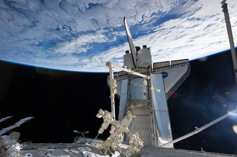 Shuttle Astronauts Haul Cargo, Get Extended Mission