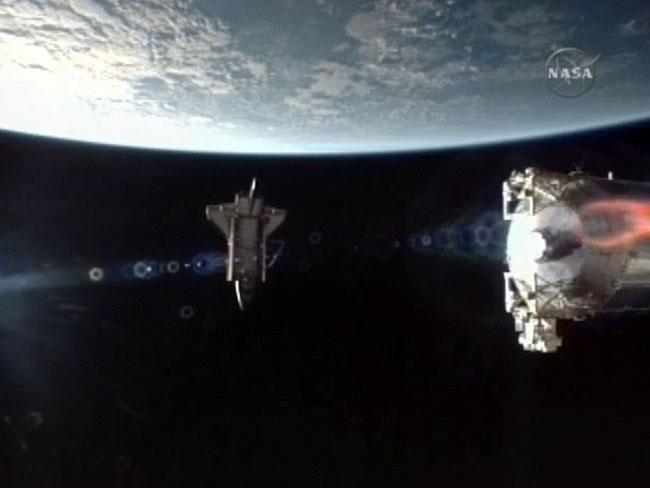 Shuttle Atlantis Bids Farewell to Space Station