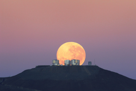 The dazzling full moon sets behind the Very Large Telescope in Chile's Atacama Desert in this photo released June 7, 2010 by the European Southern Observatory. The moon appears larger than normal due to an optical illusion of perspective. <a href=http://www.space.com/scienceastronomy/spectacular-moon-photo-over-chile-100609.html>Full Story</a>.