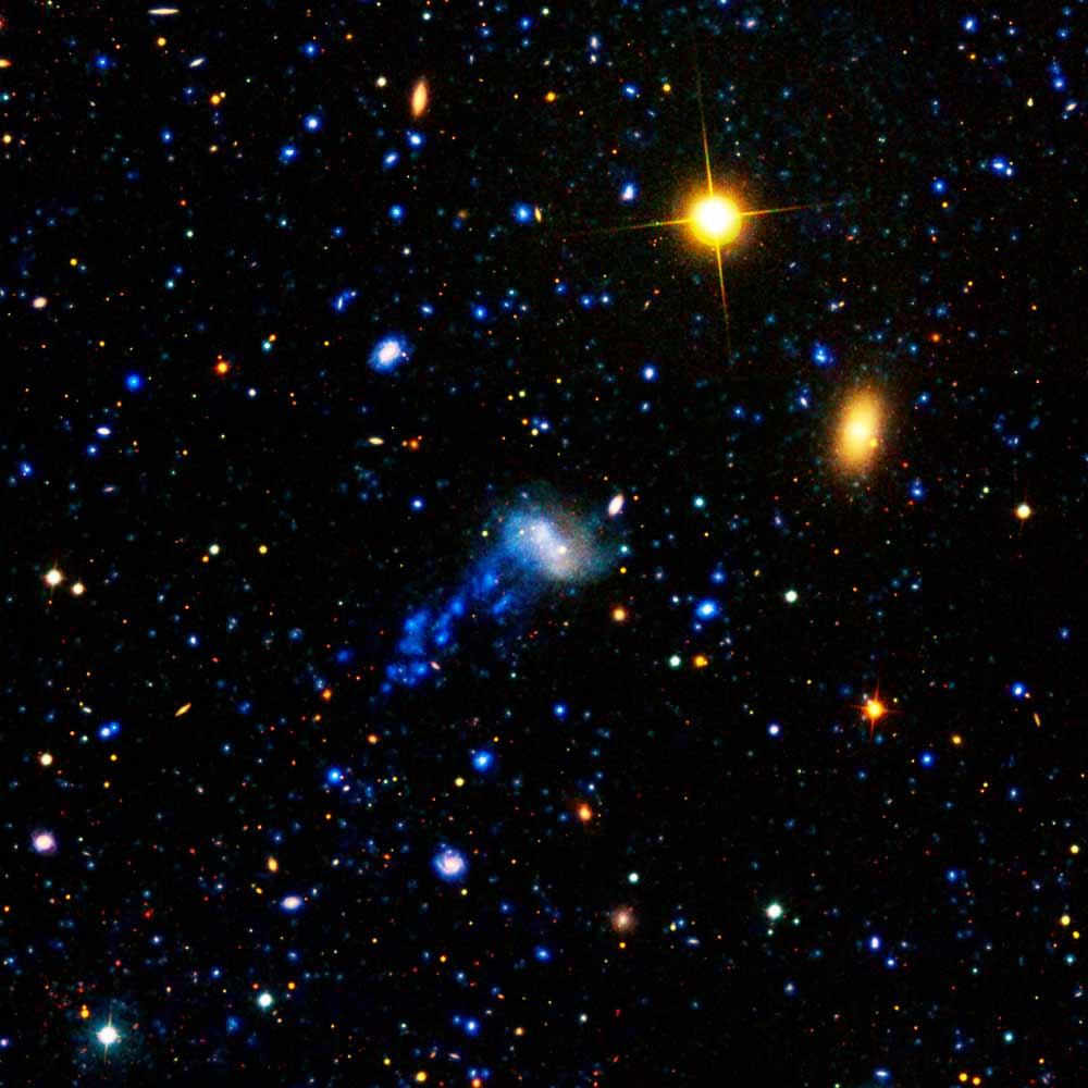 Cosmic Hit-and-Run Gives Galaxy Starry Tail