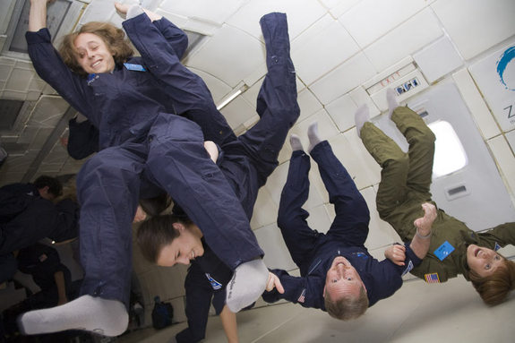 The Stern family of Colorado float in weightlessness during a Fourth of July holiday flight aboard a Zero Gravity Corporation aircraft on July 4, 2010.