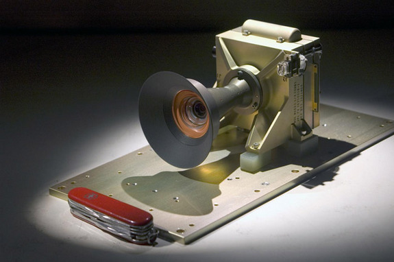 This Mars Descent Imager (MARDI) camera will fly on the Curiosity rover of NASA's Mars Science Laboratory mission. The downward-looking camera will take about four frames per second at nearly 1,600 by 1,200 pixels per frame for about the final two minutes before Curiosity touches down on Mars in August 2012. Malin Space Science Systems, San Diego, Calif., supplied MARDI and two other camera instruments for the mission. A pocketknife provides scale for the image.