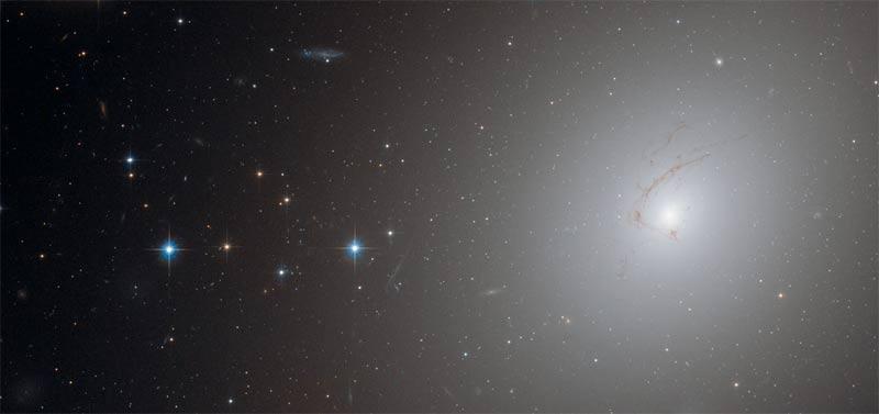 Strange Hook-Shaped Galaxy Photographed By Hubble Telescope