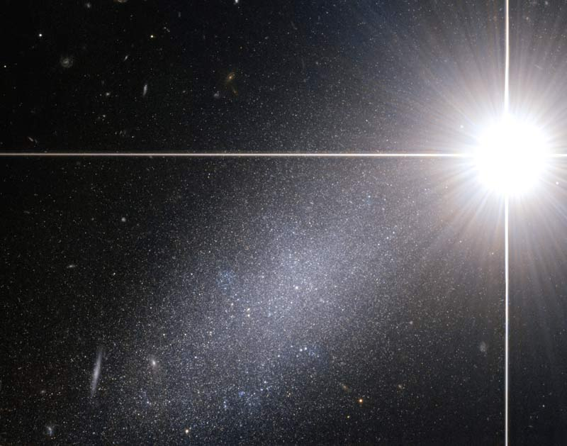 Super Bright Star Outshines Galaxy In Cosmic Photo