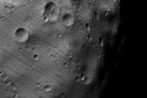 The ESA spacecraft Mars Express took this image of Phobos on March 7, 2010. This image has been enhanced for seeing features in the less-illuminated part of the moon.