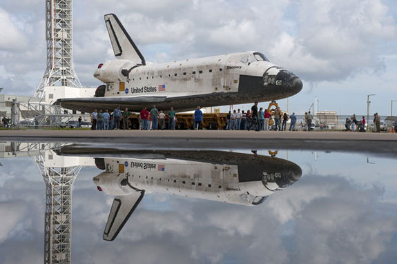 "At NASA's Kennedy Space Center in Florida, shuttle Discovery pauses for photos during its move called ""rollover"" from Orbiter Processing Facility-3 to the nearby Vehicle Assembly Building (VAB) on Sept. 9, 2010."