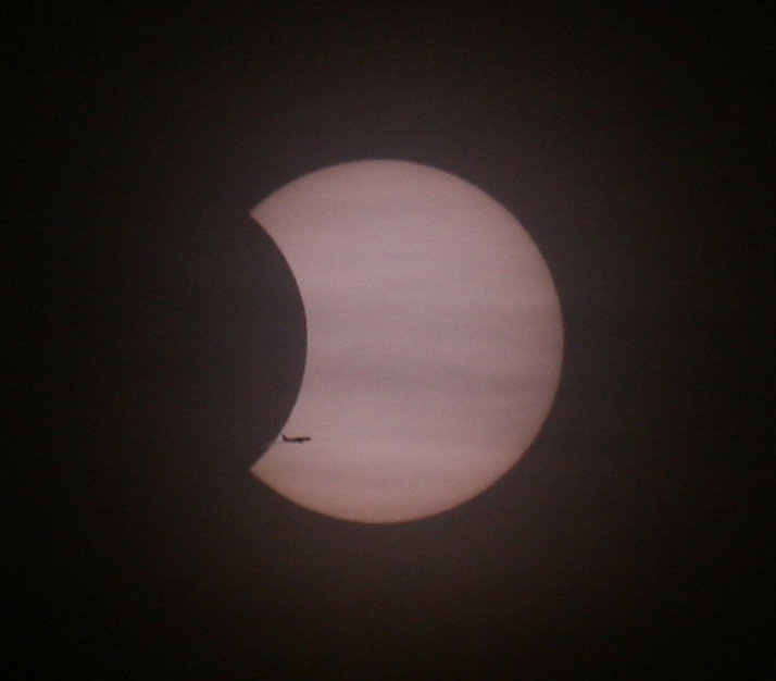 Partial Solar Eclipse and Airplane Silhouette
