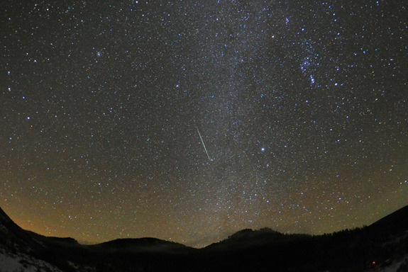A Geminid meteor streaks across the sky over Steamboat Springs, Colo., on Dec. 12, 2010.