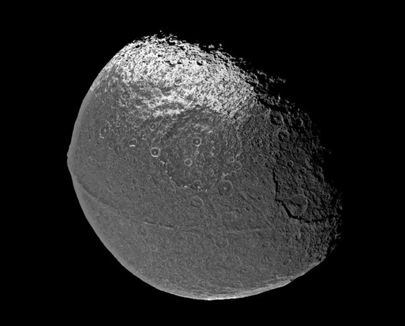 A ridge that follows the equator of Saturn's moon Iapetus gives it the appearance of a giant walnut. The ridge, photographed in 2004 by the Cassini spacecraft, is 100 kilometers (62 miles) wide and at times 20 kilometers (12 miles) high. (The peak of Mount Everest, by comparison, is 5.5 miles above sea level.) Scientists are debating how the ridge might have formed.
