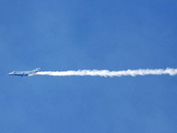 Virgin Galactic's first SpaceShipTwo passenger spacecraft leaves contrails in its wake during a Jan. 13, 2011, glide test, the fourth in a series of demonstration flights.